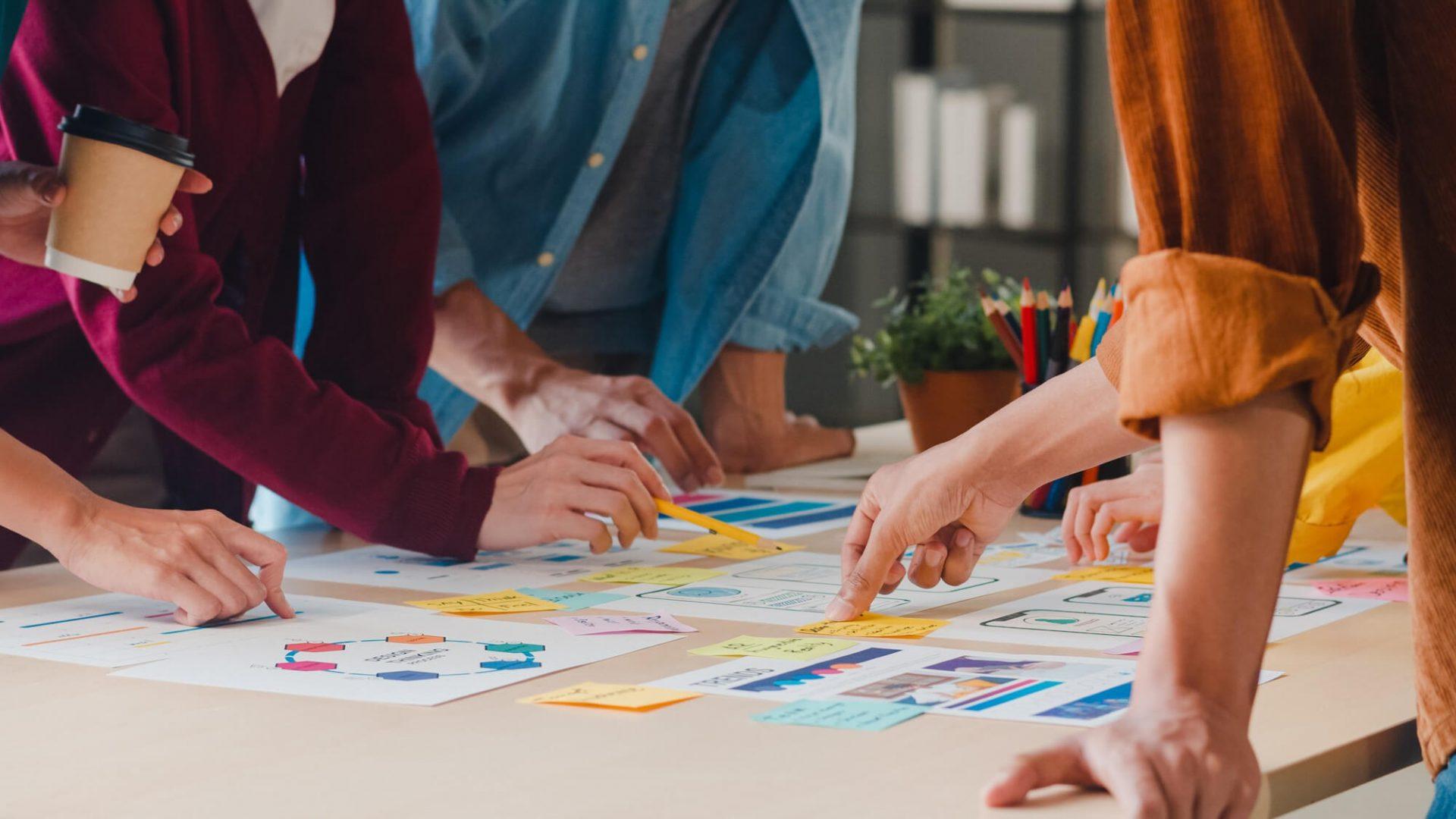 Asian businessmen meeting brainstorming ideas about creative web design