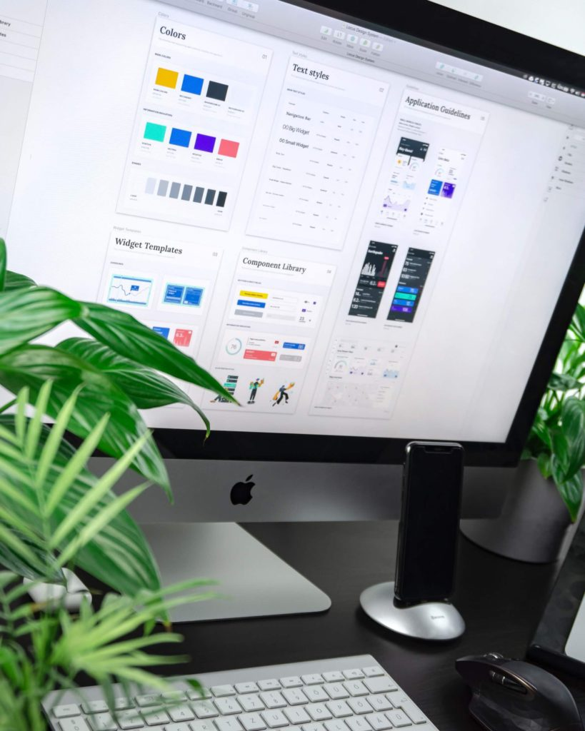 Mac Computer with a plants